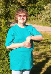 Bonnie in Strokenet t-shirt and bracelet